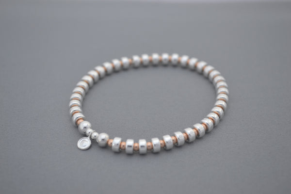 Alyssa's Signature Sterling Silver disc and Rose Gold bead bracelet