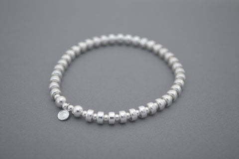 Alyssa's Signature Sterling Silver disc and Sterling Silver bead bracelet