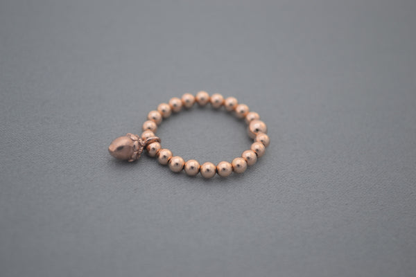 Rose Gold bead ring with acorn charm