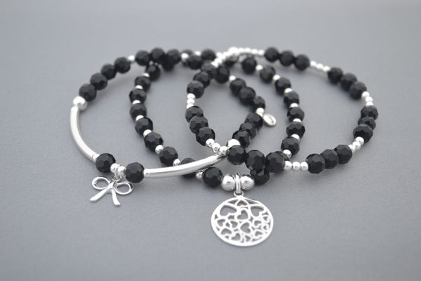 Sterling Silver and Black glass bead bracelet stack with bow and multi heart charms