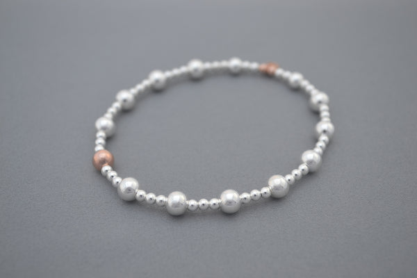 Sterling Silver and Rose Gold medium and small bead bracelet