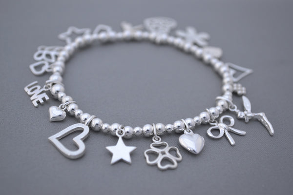 Sterling Silver 4mm bead bracelet with multi heart charms