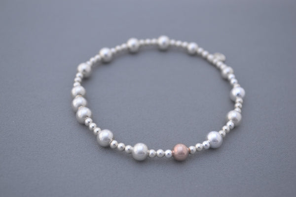 Sterling Silver small and medium bead bracelet with single Rose Gold bead detail