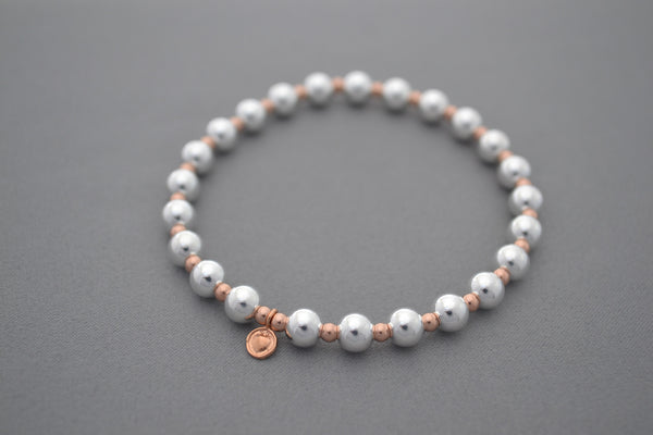 Rose Gold small ball and medium Sterling Silver bead bracelet