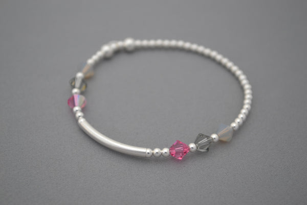 Sterling Silver noodle and round bead bracelet with pink/grey Swarovski crystals