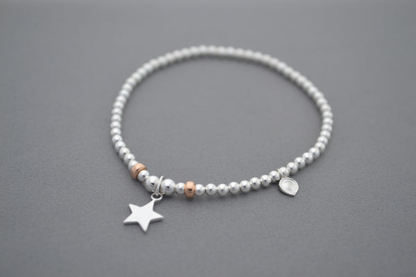 Sterling Silver and Rose Gold bead bracelet with flat star charm