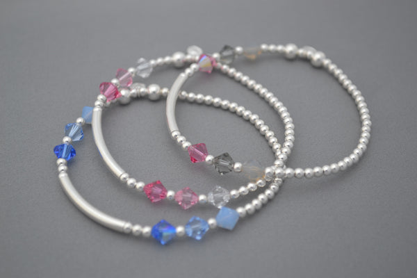 Sterling Silver noodle and round bead bracelet with blue Swarovski crystals