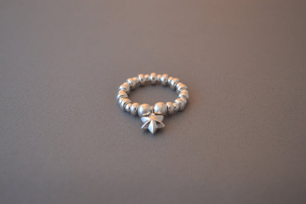Sterling silver bead and flat disc ring with small puff star charm