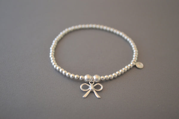 Sterling Silver bead bracelet with pretty bow charm