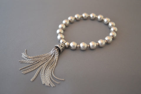 Sterling Silver large bead bracelet with Bali tassel charm
