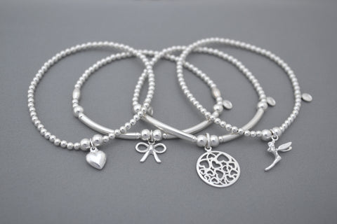 Limited Edition Sterling Silver bracelet stack - set of four bead bracelets with heart, bow and tinkerbell charms