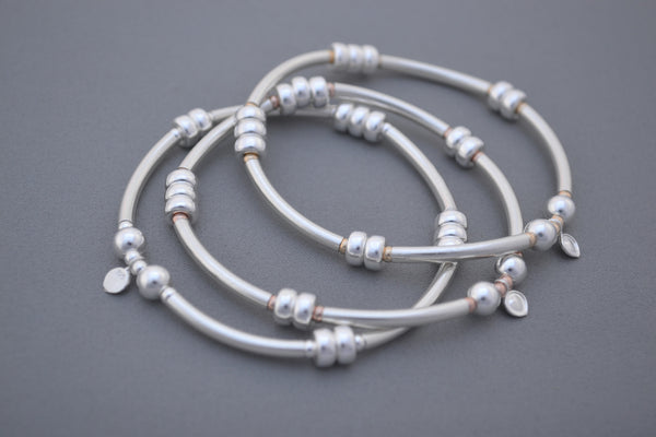 Alyssa's Signature Sterling Silver noodle and Rose Gold bead bracelet