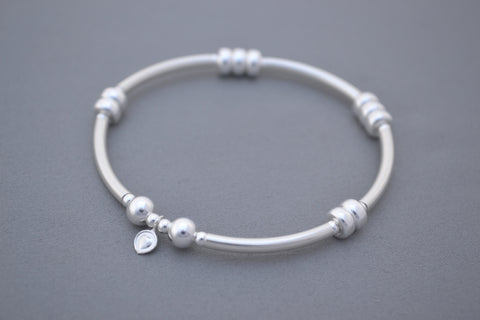 Alyssa's Signature Sterling Silver noodle and Silver disc bead bracelet
