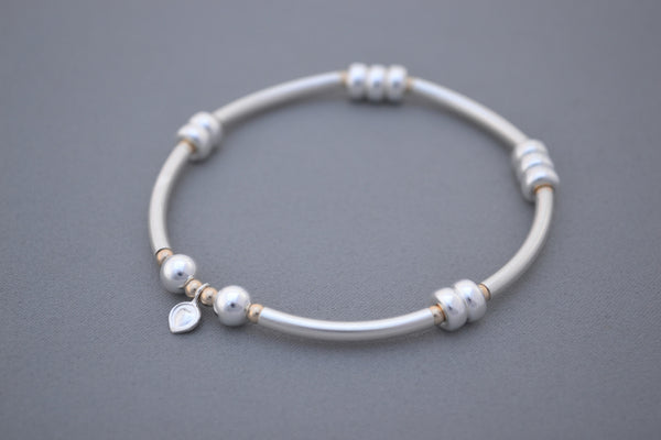 Alyssa's Signature Sterling Silver noodle and Gold bead bracelet