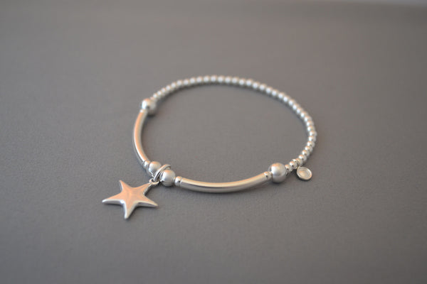 Sterling Silver half noodle and 3mm bead bracelet with puff star charm