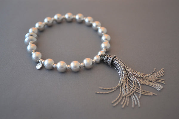 Sterling Silver large bead and disc bracelet with Bali tassel charm