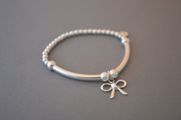 Sterling Silver round bead and noodle Children's bracelet with pretty bow charm