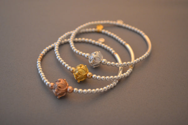 Sterling Silver noodle and bead bracelet with ornate Gold Bali bead charm