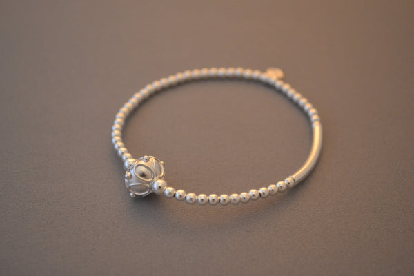 Sterling Silver noodle and bead bracelet with ornate sterling silver Bali bead charm