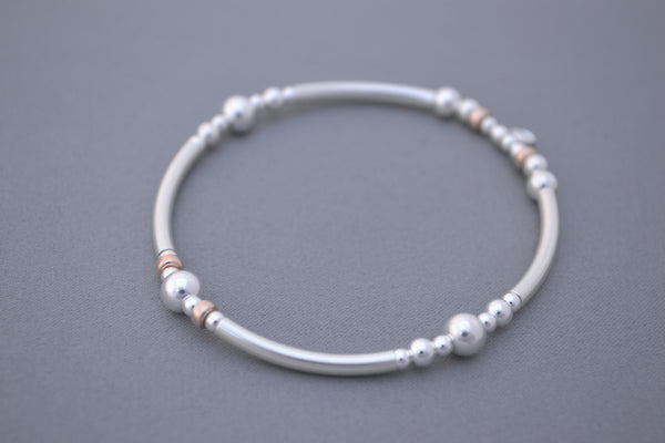 Sterling Silver noodle mixed with Rose Gold and Silver disc bead bracelet