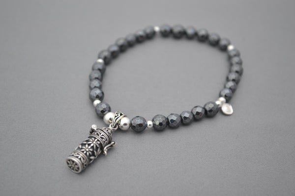 Hematite faceted and Sterling Silver bead bracelet with Bali prayer bottle