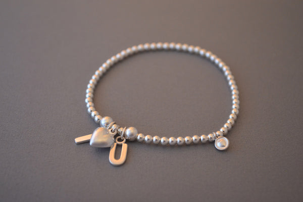 Sterling Silver bead bracelet with pretty Sterling Silver I LOVE U charms