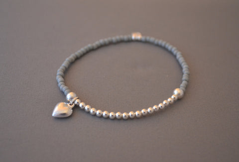 Light Grey glass seed and Sterling Silver bead bracelet with sterling silver puff heart charm