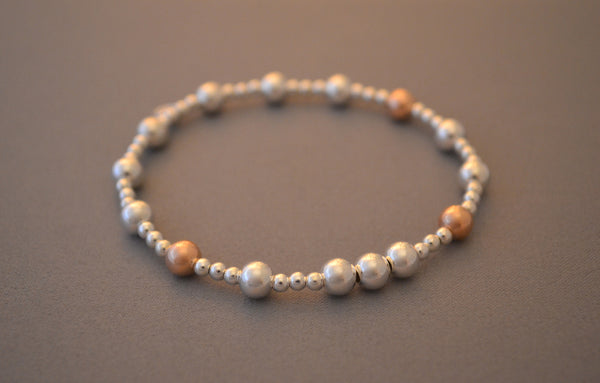 Sterling Silver and Rose Gold small and medium bead bracelet