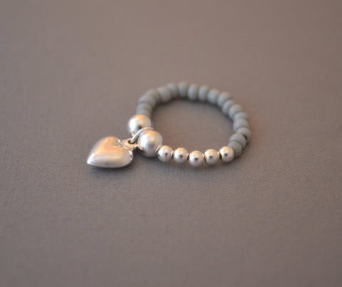 Sterling Silver ball and light grey seed bead ring with Sterling Silver puff heart charm