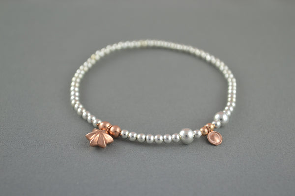 Sterling Silver ball bead bracelet with Rose Gold puff star charm