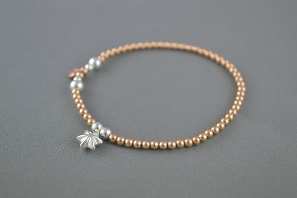 Rose Gold ball bead bracelet with Sterling Silver puff star charm