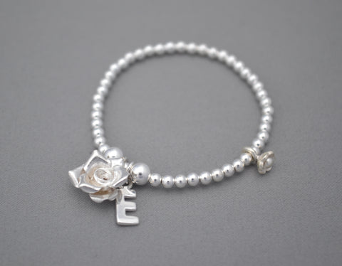 Sterling Silver bead bracelet with Sterling Silver Rose Charm Bali daisy beads and initial
