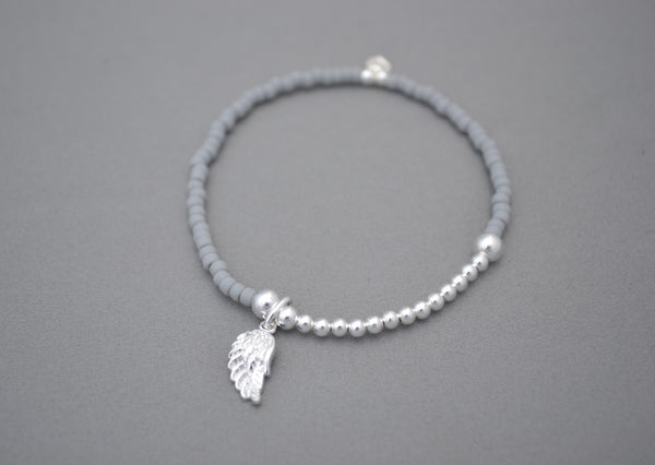 Light Grey glass seed and Sterling Silver bead bracelet with Sterling Silver angel wing charm