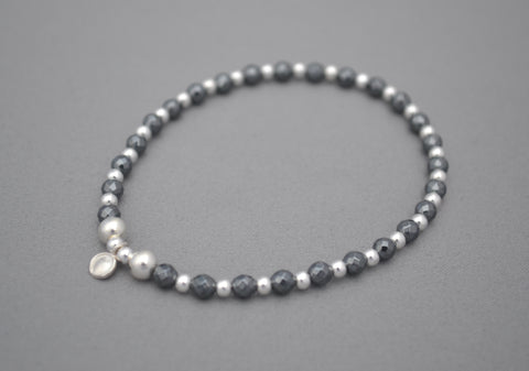 Hematite 4mm faceted and Sterling Silver mixed bead bracelet