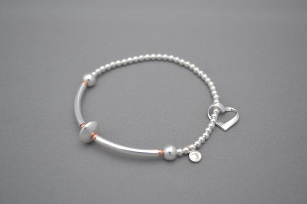 Sterling Silver noodle and small Rose Gold bead bracelet with open heart charm