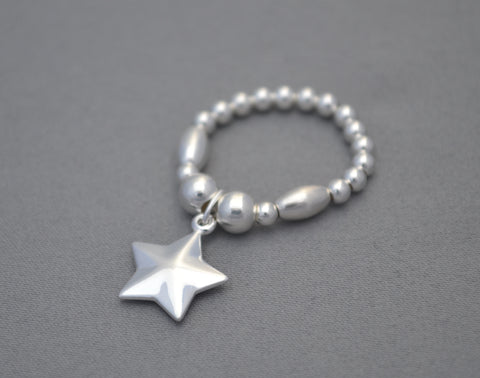 Sterling Silver rice bead ring with Sterling Silver puff star charm