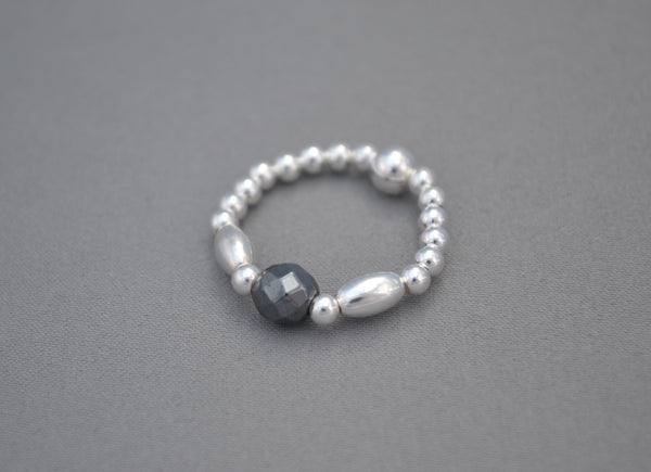 Sterling Silver rice bead ring with faceted Hematite round bead charm