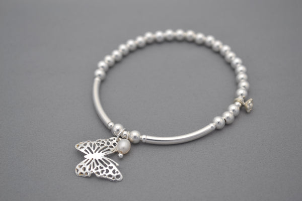 Sterling Silver 4mm and half noodle bead bracelet with pretty butterfly and pearl charms