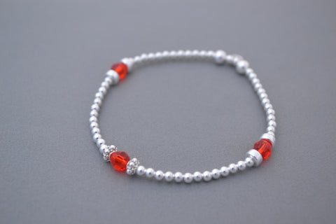 Sterling Silver handmade mixed bead disc bracelet with red accents