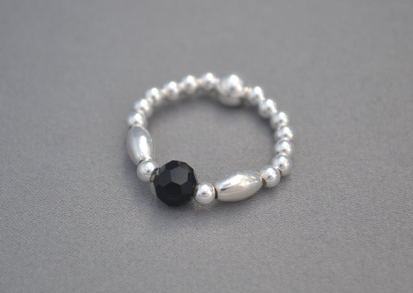 Sterling Silver rice bead ring with Black round bead charm