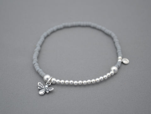 Handmade Grey seed and Sterling Silver bead bracelet with Manchester bee charm