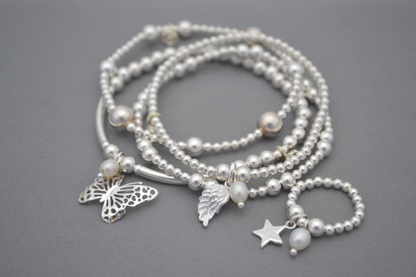 Sterling Silver 5mm and half noodle bead bracelet with pretty butterfly and pearl charms