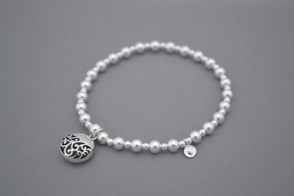 Sterling Silver 5mm and 3mm mixed bead bracelet with Bali ornate circle charm