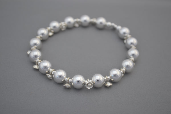 Handmade Sterling Silver 10mm and antique Bali daisy bead bracelet