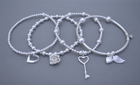 Handmade set of four 925 Sterling Silver bracelets with 925 Sterling silver heart and key angel wing charms