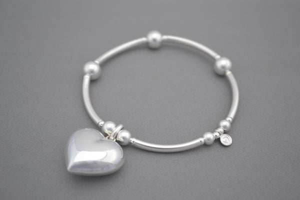 Handmade Sterling Silver noodle and bead bracelet with large puff heart charm