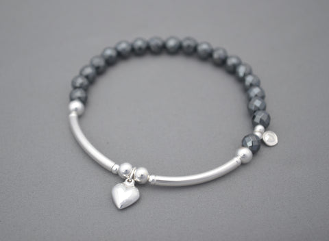 Half noodle sterling silver and hermatite bead bracelet with puff heart charm