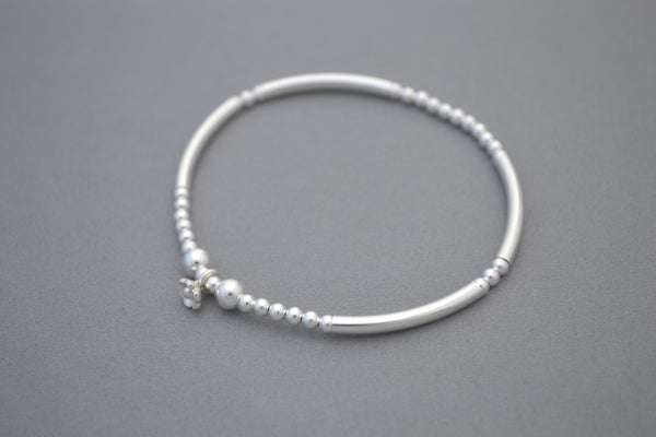 Sterling Silver 3mm bead and noodle bracelet with daisy bead charm