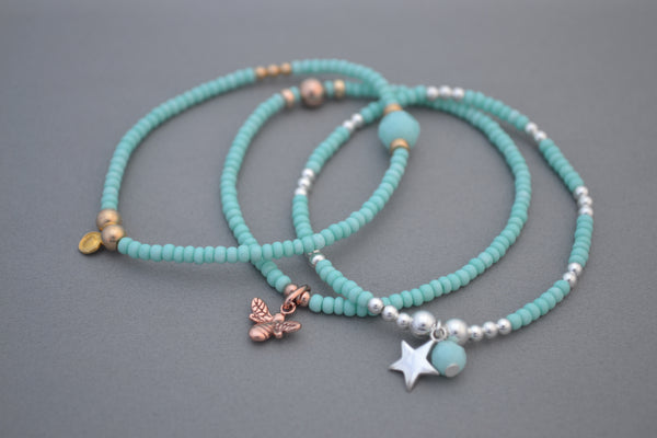 Turquoise glass seed and Rose Gold mix bead bracelet with Rose Gold Bee charm