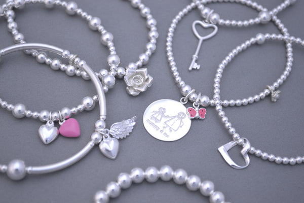 Sterling Silver noodle mixed bead bracelet with angel wing and puff heart charms
